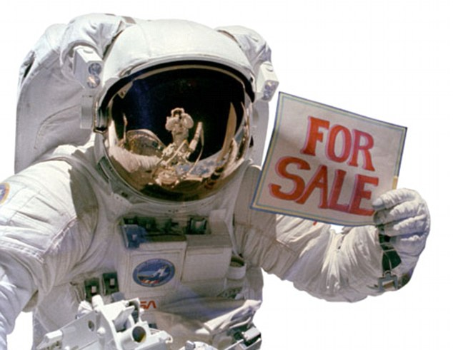 A5JF2J Astronaut with For Sale sign